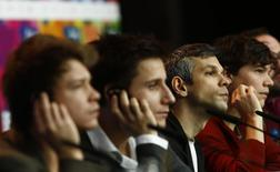 Director Adam Csaszi (2nd R) and his cast Adam Varga (L), Andras Suetoe (2nd L), Sebastian Urendowsky attend a news conference to promote the movie Viharsarok (Land of Storms) at the 64th Berlinale International Film Festival in Berlin February 8, 2014. REUTERS/Thomas Peter