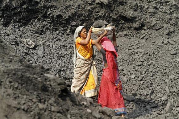 Labourers carry coal at a stockyard of an underground coal mine in the Mahanadi coal fields at Dera, near Talcher town in Orissa March 28, 2012. REUTERS/Rupak De Chowdhuri/Files