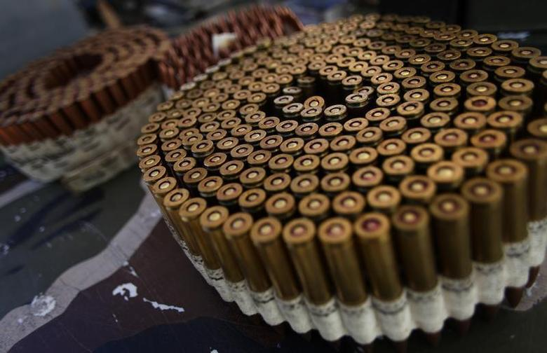 Bullets are displayed on a table in Mohave County, Arizona March 22, 2013. REUTERS/Joshua Lott