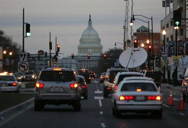 Traffic drives towards the U.S. Capitol building as they pass the outside of the new home of the Washington Nationals baseball team, Nationals Park, in Washington, March 29, 2008. REUTERS/Jason Reed/Files