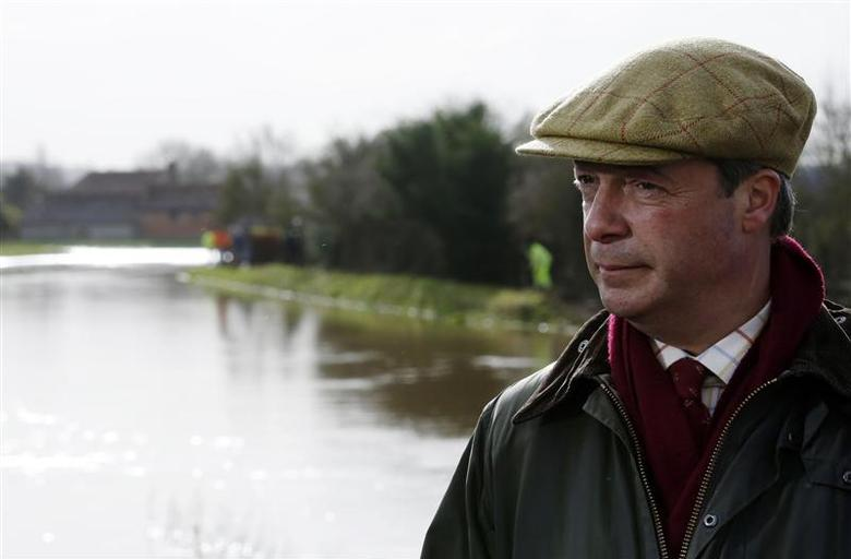 UK Independence Party leader Nigel Farage visits the village of Burrowbridge during continued flooding in Somerset, south west England February 9, 2014. REUTERS/Luke MacGregor