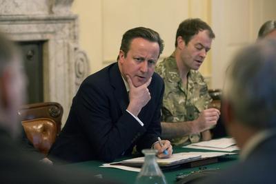 Britain's Cameron under pressure over flood spending...