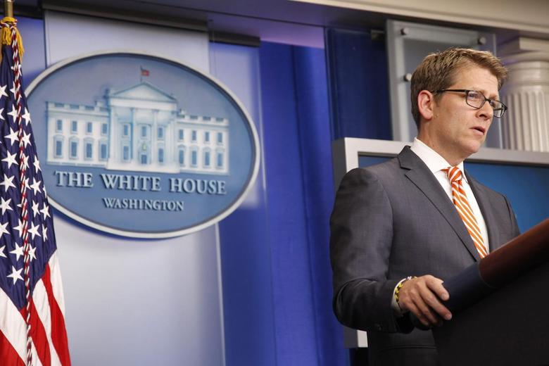 White House spokesman Jay Carney answers questions during the daily briefing at the White House in Washington December 12, 2013 file photo. REUTERS/Jonathan Ernst