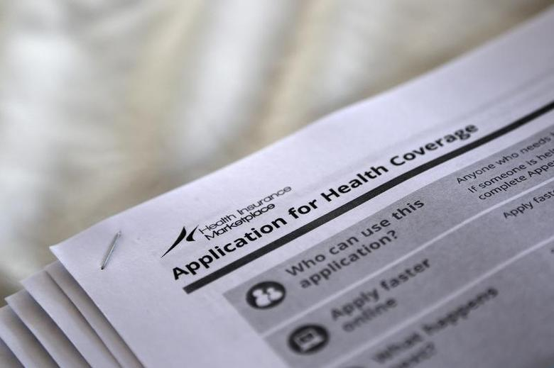 The federal government forms for applying for health coverage are seen at a rally held by supporters of the Affordable Care Act, widely referred to as ''Obamacare'', outside the Jackson-Hinds Comprehensive Health Center in Jackson, Mississippi October 4, 2013 file photo. REUTERS/Jonathan Bachman