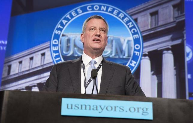 New York Mayor Bill de Blasio delivers remarks at the plenary session of the U.S. Conference of Mayors in Washington January 23, 2014 file photo. REUTERS/Joshua Roberts