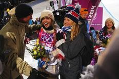 Gold medalist Kaitlyn Farrington (C) of the U.S. celebrates with her parents Gary and Suze Farrington after winning the women's snowboard halfpipe at the 2014 Sochi Winter Olympic Games in Rosa Khutor February 12, 2014. REUTERS/Lucas Jackson