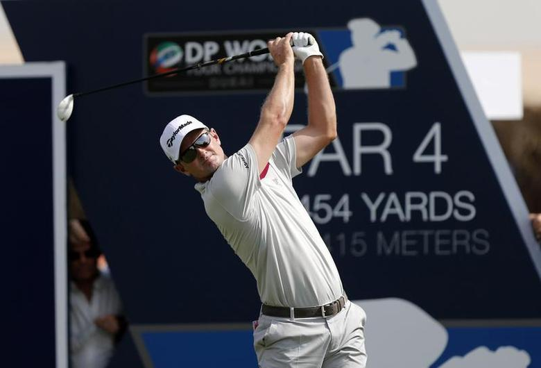 Justin Rose of England tees off on the first hole during the first round of the DP World Tour Championship golf tournament in Dubai November 14, 2013. REUTERS/Ahmed Jadallah