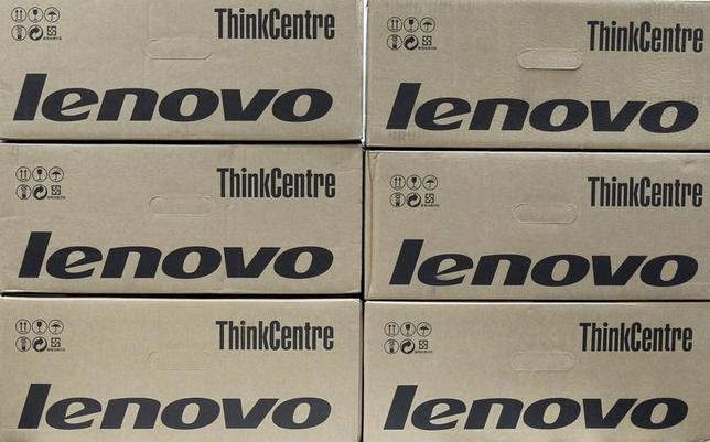 Boxes containing Lenovo desktop computers are seen in an office in Kiev March 12, 2012. REUTERS/Gleb Garanich
