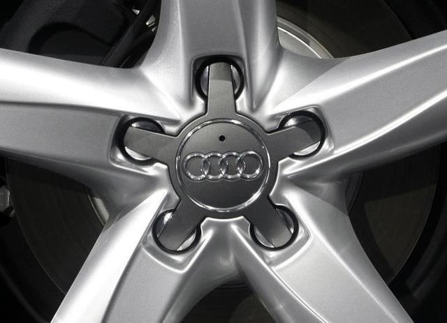 The company logo of Volkswagen's Audi AG premium unit is pictured on the hub caps of a car during the annual news conference in Ingolstadt March 11, 2008. REUTERS/Michael Dalder