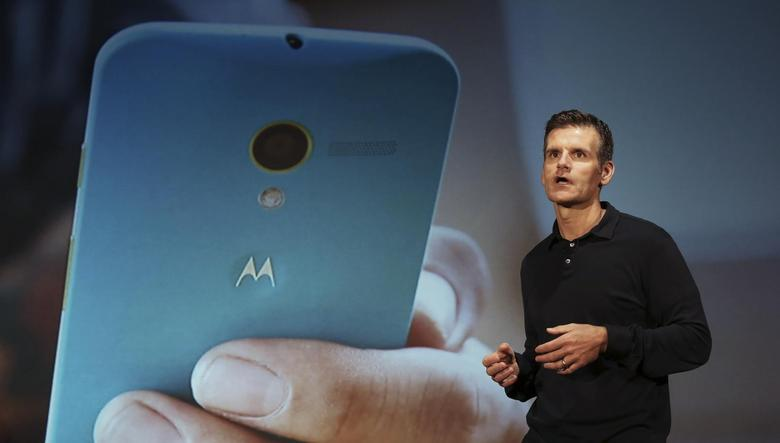 Motorola Mobility Chief Executive Dennis Woodside talks during the worldwide presentation of the Moto G mobile phone in Sao Paulo November 13, 2013. REUTERS/Nacho Doce