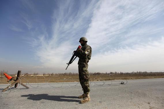 An Afghan National Army (ANA) soldier stands guard near the Bagram detainee centre gate north of Kabul February 13, 2014. REUTERS-Mohammad Ismail