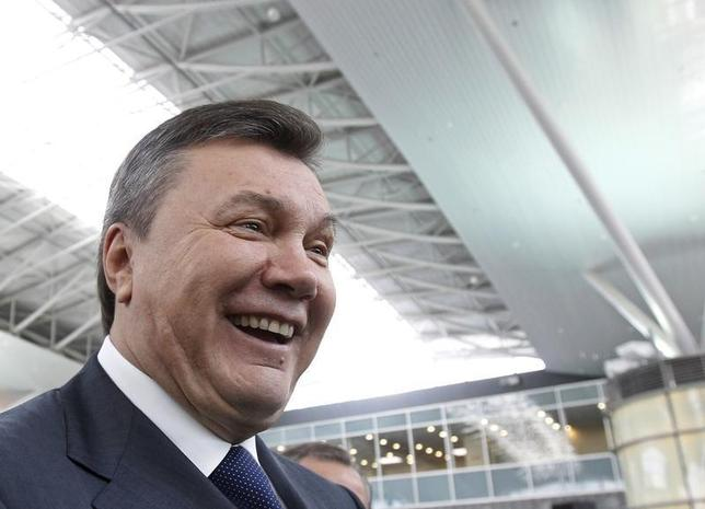 Ukraine's President Viktor Yanukovich smiles during an opening ceremony of a new terminal at Borispol airport, near the Ukrainian capital of Kiev, May 28, 2012. REUTERS/Gleb Garanich