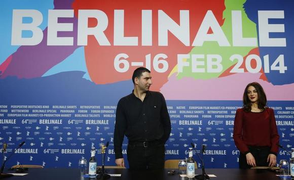 Director Yannis Economides (L) and cast member Vicky Papadopoulou arrives at a news conference to promote the movie ''To Mikro Psari (Stratos)'' at the 64th Berlinale International Film Festival in Berlin February 11, 2014. REUTERS/Thomas Peter