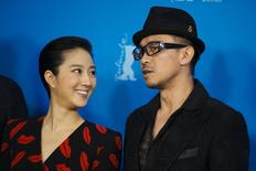 "Cast members Gwei Lun-Mei and Wang Xuebing (R) pose during a photocall to promote the movie ""Black Coal, Thin Ice"" at the 64th Berlinale International Film Festival in Berlin February 12, 2014. REUTERS/Thomas Peter"
