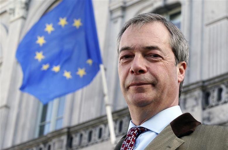 Britain's UK Independence Party (UKIP) leader and member of the European Parliament (MEP) Nigel Farage poses in front of a EU flag ahead of an interview with Reuters in Brussels February 12, 2014. REUTERS/Francois Lenoir