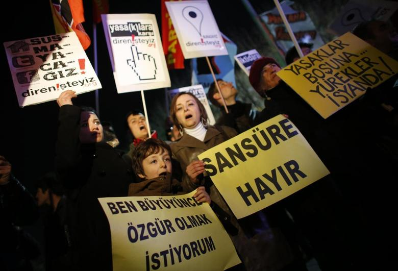 Protesters shout slogans, hold banners and wave flags as they demonstrate against new controls on the Internet approved by Turkish parliament in Ankara February 8, 2014. REUTERS/Umit Bektas