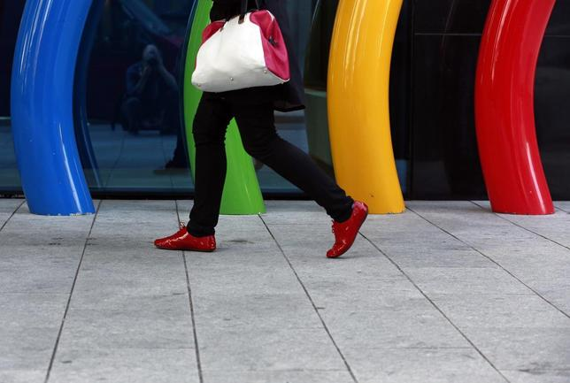 A woman walks past the Google offices near the city center in Dublin July 8, 2013. REUTERS/Cathal McNaughton