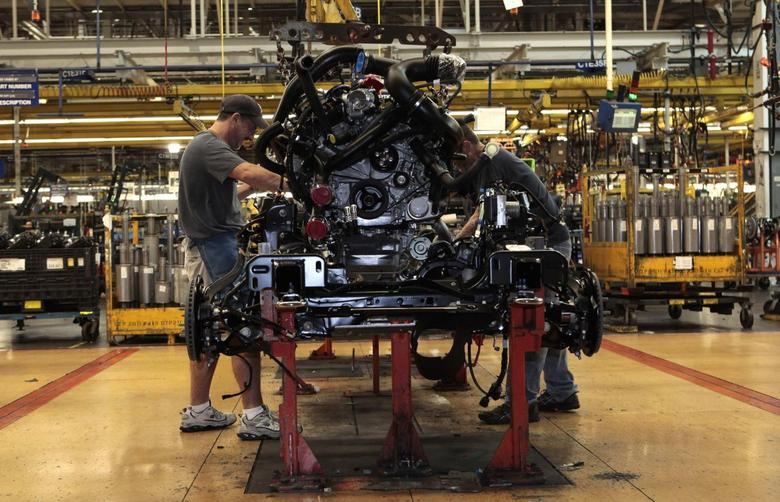 Ford Motor auto assembly workers install an EcoBoost fuel efficient engine in the chassis of a 2014 F-150 pick-up truck at the Dearborn Truck Plant in Dearborn, Michigan September 16, 2013. REUTERS/Rebecca Cook