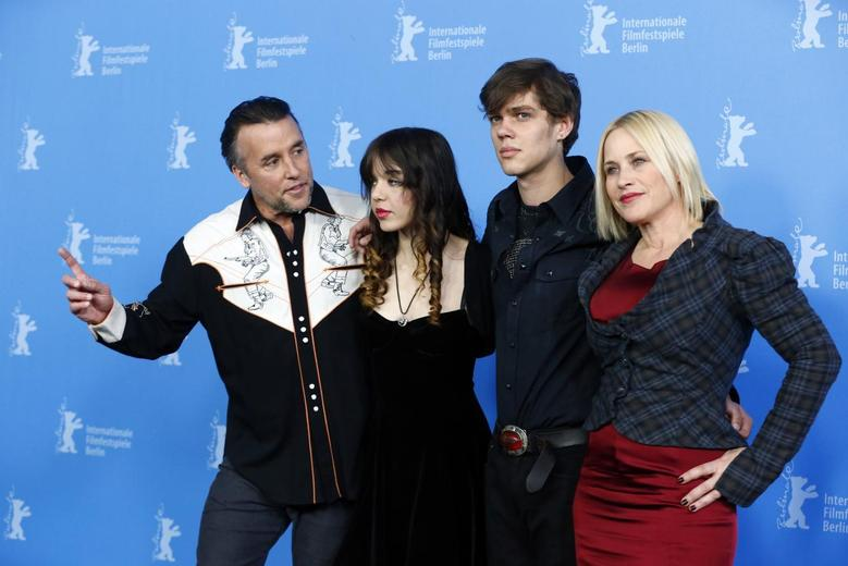 Director, screenwriter and producer Richard Linklater and cast members Lorelei Linklater, Ellar Coltrane and Patricia Arquette (L-R) pose during a photocall to promote the movie ''Boyhood'' during the 64th Berlinale International Film Festival in Berlin February 13, 2014. REUTERS/Tobias Schwarz