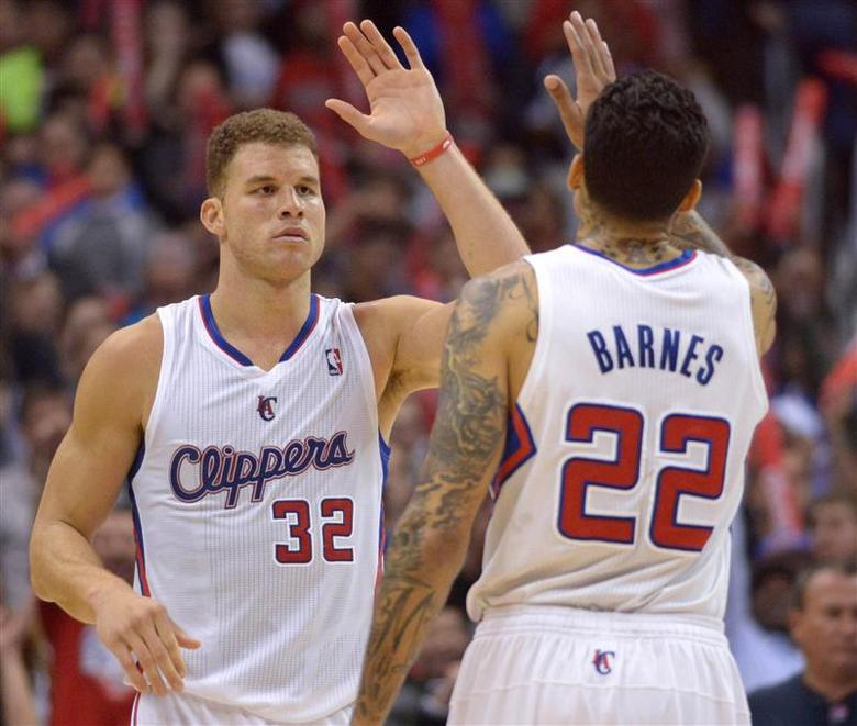 Los Angeles Clippers forwards Blake Griffin (32) and Matt Barnes (22) exchange high fives in the fourth quarter against the Portland Trail Blazers at Staples Center. The Clippers defeated the Trail Blazers 122-117. Mandatory Credit: Kirby Lee-USA TODAY Sports