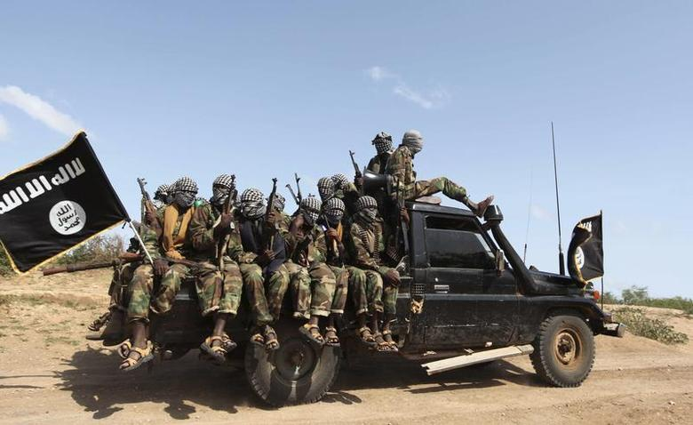 Members of al Shabaab, al Qaeda-linked insurgents, ride in a pick-up truck after distributing relief to an internally displaced camp outside Somalia's capital Mogadishu, September 3, 2011. A confidential U.N. report, obtained by Reuters, says some arms are believed to be have been diverted from Somali authorities to al Shabaab.'' REUTERS/Feisal Omar
