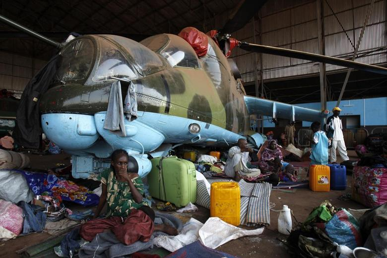 Muslims sit at a camp for displaced people at Mpoko international airport in Bangui, as they wait to leave the capital, February 13, 2014. REUTERS/Luc Gnago