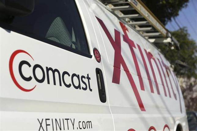 A Comcast sign is shown on the side of a vehicle in San Francisco, California February 13, 2014. REUTERS/Robert Galbraith