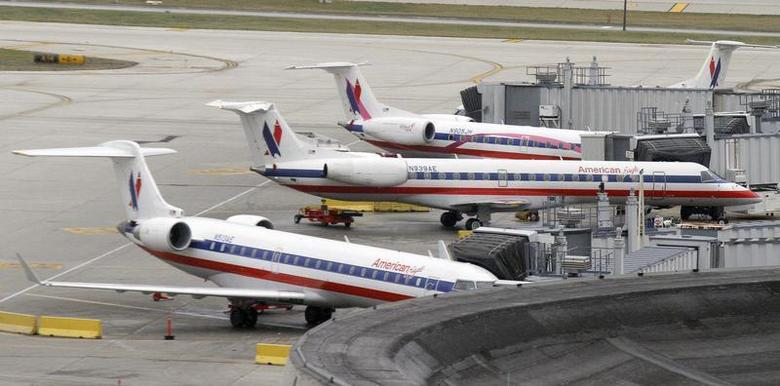 American Eagle planes sit at their gate at O'Hare International airport in Chicago November 29, 2011. REUTERS/Frank Polich