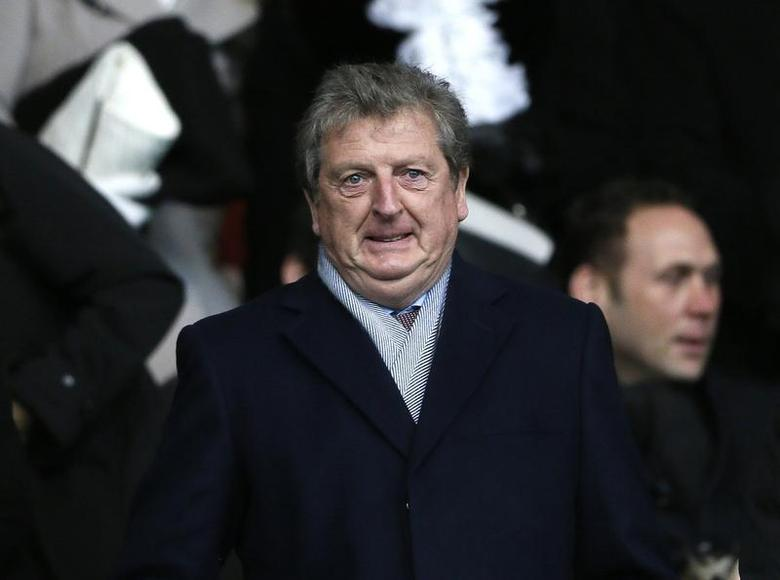 England manager Roy Hodgson prepares to watch Chelsea play Southampton in their English Premier League soccer match at St Mary's stadium in Southampton, southern England January 1, 2014. REUTERS/Stefan Wermuth