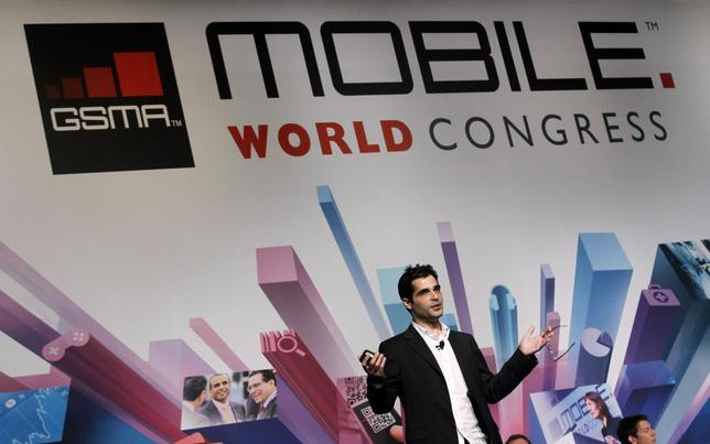 Viber's Founder and Chief Executive Marco Talmon gestures during a news conference at the Mobile World Congress in Barcelona in this February 26, 2013 file photo. REUTERS/Albert Gea/Files