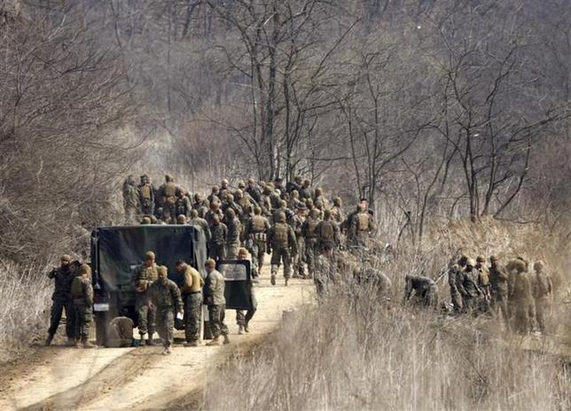 U.S. soldiers arrive for their military training near the demilitarized zone (DMZ) separating North Korea from South Korea in Paju, north of Seoul April 8, 2013. REUTERS/Lee Jae-Won/Files