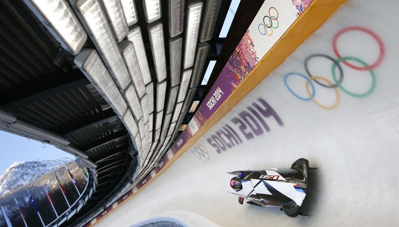 Two-women bobsleigh pilot Elana Meyers of the U.S. speeds down the track during unofficial progressive training at the Sanki Sliding Center in Rosa Khutor, a venue for the Sochi 2014 Winter Olympics near Sochi, February 6, 2014. REUTERS/Fabrizio Bensch