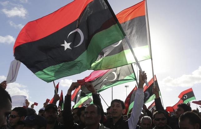 People wave Libyan flags during a demonstration in Benghazi February 7, 2014. REUTERS/Esam Omran Al-Fetori