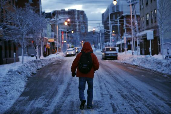 A man makes his commute after a night of snow in Jersey City, New Jersey, February 14, 2014. REUTERS/Eduardo Munoz