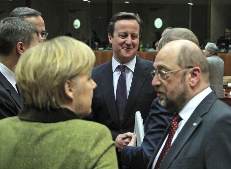 Germany's Chancellor Angela Merkel (L), Britain's Prime Minister David Cameron (C) and European Parliament President Martin Schulz (R) attend an European Union leaders summit meeting to discuss the European Union's long-term budget in Brussels February 7, 2013. REUTERS/Yves Herman