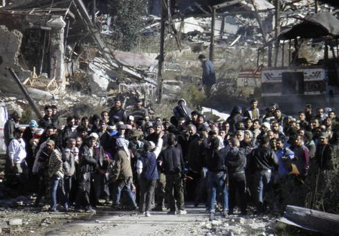 Homs rebel puts fate in Syrian government hands