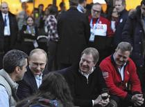 Russia's President Vladimir Putin (2nd L) sits next to to United States Olympic Committee (USOC) chairman Larry Probst (2nd R) as he visits Team USA House at the U.S. Olympic Committee headquarters in the Olympic Park during the Sochi 2014 Winter Olympics Games, February 14, 2014. REUTERS/Mikhail Klimentyev/RIA Novosti/Kremlin