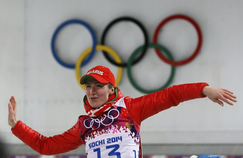 Belarus' Darya Domracheva celebrates during the flower ceremony for the women's biathlon 15km individual event at the 2014 Sochi Winter Olympics February 14, 2014. REUTERS/Stefan Wermuth
