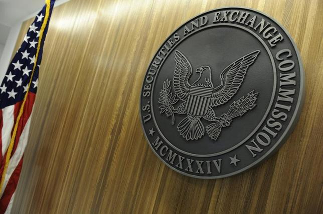 The seal of the U.S. Securities and Exchange Commission hangs on the wall at SEC headquarters in Washington, June 24, 2011. REUTERS/Jonathan Ernst