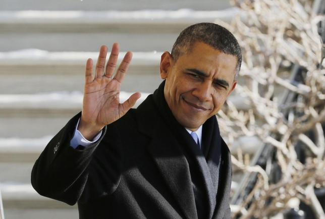 U.S. President Barack Obama waves before departing the White House in Washington, February 14, 2014. REUTERS/Larry Downing