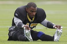 New Orleans Saints safety Darren Sharper stretches before practice at the University of Miami practice facility in Coral Gables, Florida February 3, 2010. REUTERS/Jeff Haynes