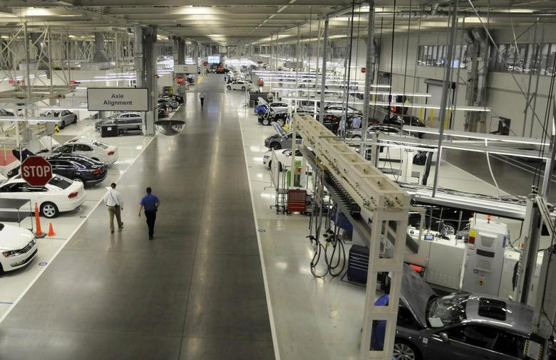 Two Volkswagen employees walk through the axle alignment department at the VW plant in Chattanooga, Tennessee in this December 1, 2011 file photo. REUTERS/Billy Weeks/Files