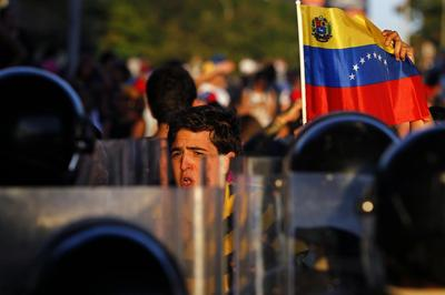 Anti-Maduro protests persist in Venezuela, dozens...