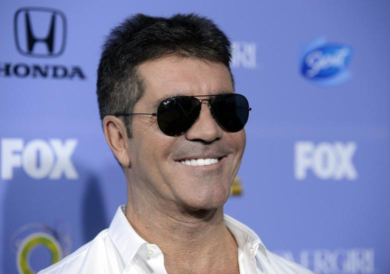 Judge Simon Cowell attends ''The X Factor'' season three premiere event in West Hollywood, California September 5, 2013. REUTERS/Phil McCarten