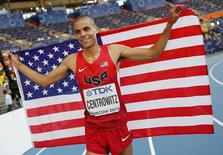 Matthew Centrowitz of the U.S holds up his national flag as he celebrates winning second place in the men's 1500 metres final during the IAAF World Athletics Championships at the Luzhniki stadium in Moscow August 18, 2013. REUTERS/Dominic Ebenbichler