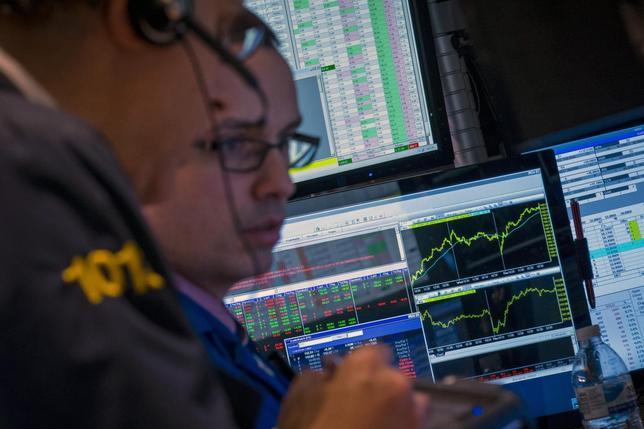 Traders work on the floor of the New York Stock Exchange February 13, 2014. REUTERS/Brendan McDermid