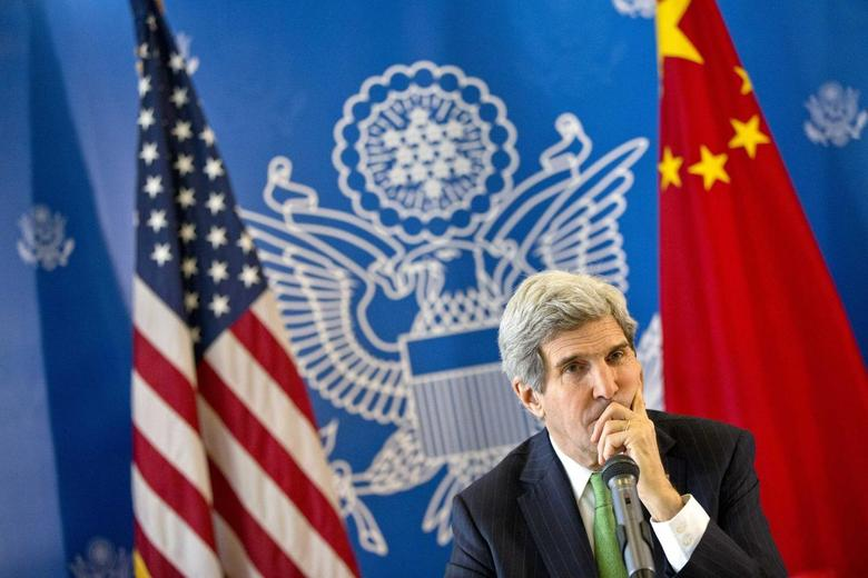 U.S. Secretary of State John Kerry listens to a question during a discussion with Chinese bloggers in Beijing February 15, 2014. REUTERS/Evan Vucci/Pool
