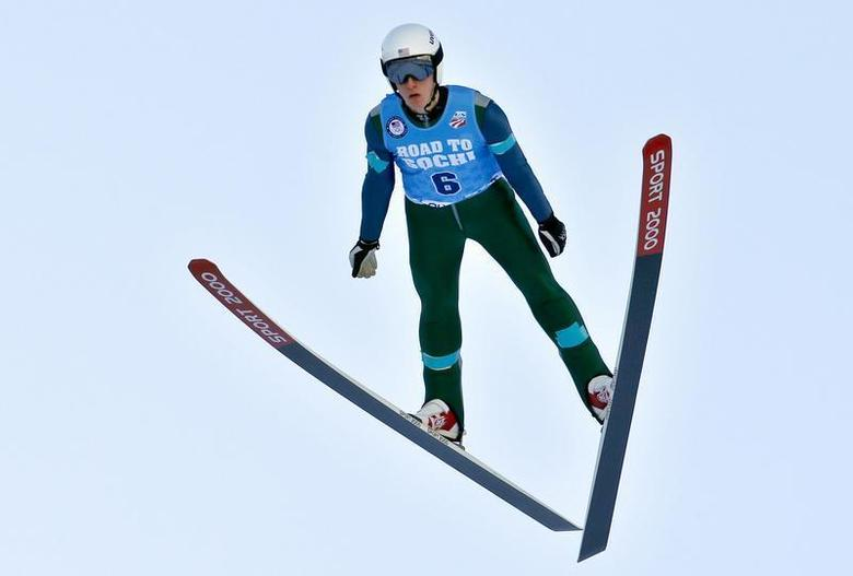 Dec 29, 2013; Park City, UT, USA; Nicholas Fairall of the United States is airborne during his ski jump during the U.S. Olympic Trials at the Utah Olympic Park. Mandatory Credit: Nathan Bilow-USA TODAY Sports - RTX16WXP