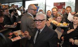 "Director Martin Scorsese signs autographs as he arrives on the red carpet before the screening of ""Untitled New York Review of Books Documentary"" at the 64th Berlinale International Film Festival in Berlin February 14, 2014. REUTERS/Tobias Schwarz"