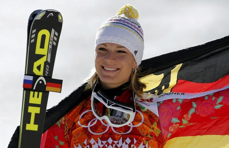 Second-placed Germany's Maria Hoefl-Riesch poses on podium during the flower ceremony for the women's alpine skiing Super G competition during the 2014 Sochi Winter Olympics at the Rosa Khutor Alpine Center February 15, 2014. REUTERS/Leonhard Foeger